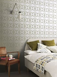 An all over, beaded wallcovering design featuring a beaded geometric star motif.