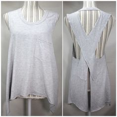 Reserved Free People Gray Open Back Top Excellent condition with one tiny spot shown in last picture - barely noticeable but I wanted to mention it. Will possibly come out with stain remover. Fits small or medium. Great for summer and the beach! Very rare and sold out! Trade value $100 Free People Tops Tank Tops