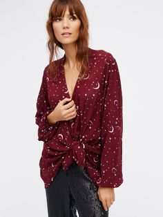 Julia Printed Blouse | Pretty, lightweight semi-sheer blouse featuring a galaxy-inspired print and a slight high-low hem. Front button closures.