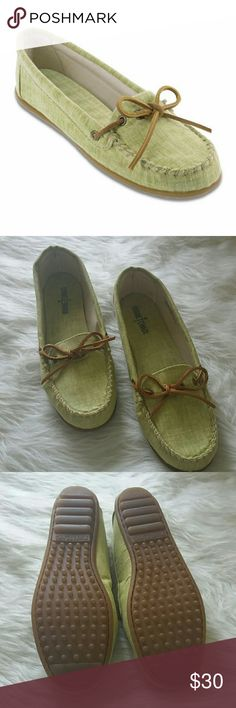 Minnetonka green canvas flats So cute and super comfy too! NWOT. Canvas outer and inside sole. Rubber grooved outside sole. Leather tie. Minnetonka Shoes Flats & Loafers