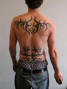 This one of the most ideal lower back tattoos for guys who want some tribal patters on their bodies. The tattoos pattern represents several tribal patterns drawn on three levels, one above the other to give the tattoo a complex layered look. Tribal Back Tattoos, Cool Chest Tattoos, Girl Back Tattoos, Back Tattoos For Guys, Back Tattoo Women, Tribal Tattoo Designs, Tattoos For Women, Spine Tattoos, Men Tattoos