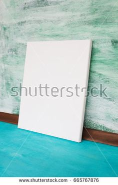 Mockup of a poster leaning against a wall. White empty canvas in a stylish interior.