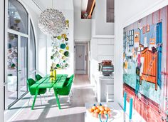 When architect David Hotson and designer Ghislaine Viñas got their hands on a four storey penthouse apartment in New York, there was no holding back. Together they designed the unexpected - neon furniture, a rock climbing wall and a tubular steel slide within a stark white shell.