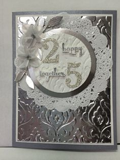 25th Anniversary by Eileen Engel (USA - AZ), Cased the card layout from Heidi Weaver for my 25th Wedding Anniversary next week. Time sure flies!  CS: Brushed Silver, Silver Foil Sheets, WW, White Vellum Stamps: Express Yourself,Perfect Pennants Access: Silver, EP, Circles Framelits, Little Leaves Sizzlit, Beautiful Baroque EF, Dazzling Details Silver, Tea Lace Paper Doilies,Timeless Type Junior Sizzlits (retired), Crystal Effects, Dimentionals