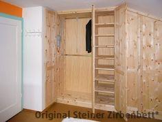 Schlafzimmerschrank aus Zirbenholz mit Kleiderlift, Maßeinbau in Mansarde