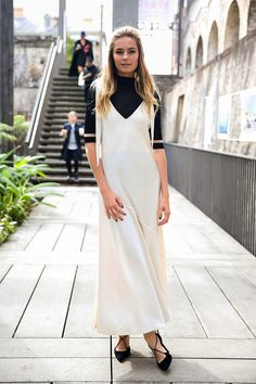Australian Fashion Week street style: this girl's working a black turtle neck under a white dress with cage heels