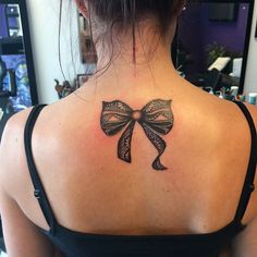 Lace bow tattoo