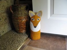 Fox door stop for baby's room - weight with bag of aquarium gravel. Use oatmeal tube as cylinder.