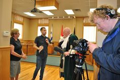 New Glasgow town crier Jim Stewart helps out a Scottish TV show crew by holding the microphone while they interview local historian Lynn MacLean. They were in Pictou County this week to find out about the connections between Scotland and New Scotland. CAROL DUNN – THE NEWS Jim Stewart, Atlantic Canada, Historian, Glasgow, Scotland, How To Find Out, Interview, Tv Shows, News