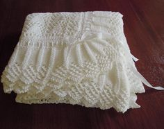 Knitted in a beautiful soft cotton, this beautiful blanket is sure to become a family heirloom. Ribbon trim can be changed to any colour making this suitable for baby boy or girl. Would also make an exquisite Christening shawl. Looks complicated however is really quite simple to knit, suitable for the intermediate knitter.Please note: If knitting in wool we suggest you add an extra ball or two of yarn.