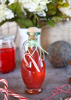 Candy Cane Vodka - easy to make homemade liquors like this peppermint flavored vodka! -perfect for holidays like Christmas. A great edible gift for neighbors, co-workers, friends & relatives. on kleinworthco.com