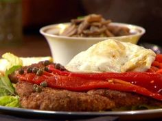 Get Paprika Chicken Schnitzel with Fried Eggs (Holstein) Recipe from Food Network