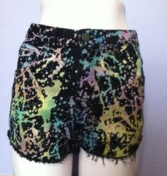 i bleached these shorts then tie dyed them with a bunch of colors. the bottoms are shredded and cut pretty short    tag size 9 would probably best fit a