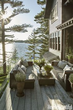 This beautiful lake cottage in Ontario belongs to designer Anne Hepfer . Elevated high above water, this custom home feels like a giant tr. Summer House Interiors, Dream House Interior, Cottage Interiors, House Of Philia, Landscape Design Plans, Landscape Architecture Design, House Landscape, House With Porch, House Front