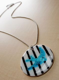 DIY Shrinky Dink Dimensional Magic necklace - I really like how he bird blurred unexpectedly