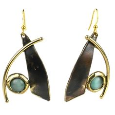 Handcrafted in South Africa, these abstract darkened brass earrings are accented with aqua tiger eye stones and brilliant brass.