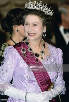 Queen Elizabeth II in Portugal wears a necklace and brooch of amethyst jewels which originally belonged to Queen Victoria's mother, The tiara known as 'Granny's Tiara' was originally given to Queen Mary on her marrriage