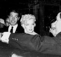 "Marilyn and Joe DiMaggio at the premiere of ""The Seven Year Itch"" at Loew's State Theatre in Times Square, New York, June 1st 1955."