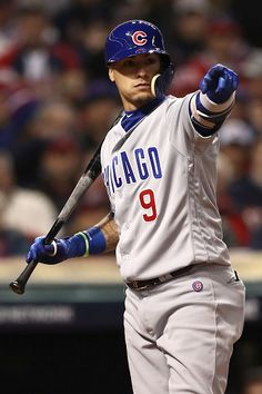 Javier Baez of the Chicago Cubs gestures during the second inning against the Cleveland Indians in Game One of the 2016 World Series at Progressive...
