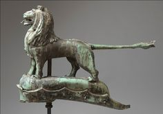 "Remarkable Early Full Bodied Lion Form Weathervane, Weathered Sheet Copper with Exceptional Natural Verdigris and Naturally Developed Patina.  English, c.1790.  30"" high x 41"" wide x 7"" deep."