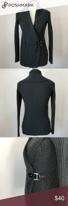 "Lauren Ralph Lauren wrap sweater with buckle Lauren Ralph Lauren in size XS. Dark heather gray. Wrap has an inner string that secures the front flap to the inner side of the sweater. This ensures a crisp look when the buckle is clasped on the outside. Two inner hanger strings. Buckle is a black faux leather with three buckle holes. Hardware is done in silver. Buckle and emblem are stamped RLL. No condition issues such as pilling, fading or stains. Bust approximately 18"", sleeves 24"", length…"