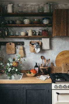 love this modern rustic rural kitchen styled by Jeska of The Future Kept with concrete walls, open rustic wood shelving and rustic wooden boards and spoons with textural ceramics. Click through for more modern rustic country interiors you'll love Home Decor Kitchen, Diy Kitchen, Kitchen Rustic, Kitchen Ideas, Wooden Worktop Kitchen, Kitchen Cabinets, Wooden Kitchens, Green Country Kitchen, Kitchen Interior Diy