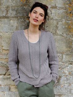Bovary - This scoop neck sweater by Martin Storey features in the Summerlite DK collection. It features an unusual hem detail and all over texture and would it be suitable for the less experienced knitter.