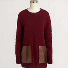 J Crew Sweater Maroon wool sweater with pleather detail pockets that are real pockets. Comfy and stylish. Hits below the waist. J. Crew Sweaters Crew & Scoop Necks