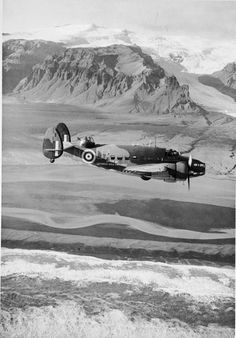 """Hudson Mark III (long-range version), T9465 'UA-N' """"Spirit of Lockheed-Vega Employees"""", of No. 269 Squadron RAF Detachment based at Kaldadarnes, Iceland, flying along the coast of Iceland. T9465 was a presentation aircraft, paid for by contributions from the workforce of the Lockheed plant at Burbank, California. ~ BFD"""