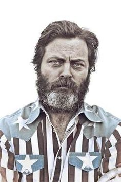 I don't generally support beards on men that work inside, but Nick Offerman in a flag shirt worn Miami Vice style is 100% tough guy