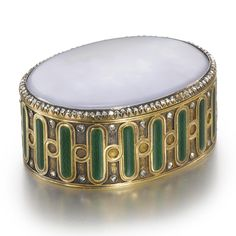 A FABERGÉ DIAMOND-SET GOLD, ENAMEL, AND AGATE SMALL OVAL BOX, WORKMASTER MICHAEL PERCHIN, ST. PETERSBURG, CIRCA 1899-1903 oval, the hinged lid set with a polished piece of blue cloud agate surrounded by rose-cut diamonds, the sides decorated with bands of green guilloché enamel alternating with gold circles, the upper and lower edges of the sides set with rose diamonds, the underside similarly decorated