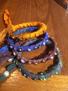 Bangles wrapped with recycled sari silk ribbon and mini pearls and other beads