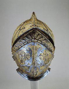 Burgonet    Date:      about 1550  Culture:      French  Medium:      Steel, blued and gilt  Dimensions:      Height: 14 in. (35.6 cm), Gr. width: 8 1/4 in. (21 cm), Gr. depth: 14 1/4 in. (36.2 cm), Weight (without buffe): 4.2lb. (1.9kg), Weight (with buffe): 5.3lb. (2.4kg)  Classification:      Helmets  Credit Line:      Rogers Fund, 1904   Accession Number:      04.3.217