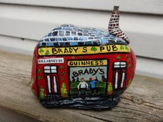 Unique Irish pub painted on garden rock by Lizzarttcreations