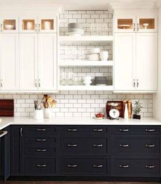 This two-tone kitchen flaunts the trendy black and white style, open shelving and subway tile. Be sure to visit our board Kitchen Design Gallery for more!