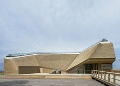 http://www.dezeen.com/2012/11/09/takern-visitor-centre-with-thatched-walls-by-wingardhs/