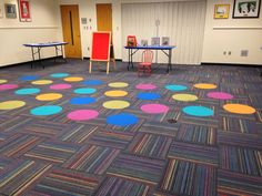 Take a seat on these Viva Colores circles within Roy G Biv Interface carpet tile