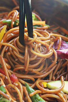 Rainbow Asian Skillet Peanut Noodles - Super easy & delicious peanut noodle stir-fry is made with gluten free pasta noodles, colorful veggies and a sweet and savory peanut sauce that comes together in under 30 minutes. Perfect for weeknights!