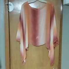 Blouse Cute pullover sheer top w/handkerchief sleeves. Orange plum, and peachy color. Last pic show a very small tare at the shoulder. Tops