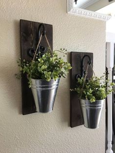 This is a unique set of wall sconces with a galvanized bucket and whispy boxwood. It measures 5 wide and 14 tall. It includes everything you see and there is a sawtooth hanger for easy hanging. You can customize the wood finish to match your decor! Scroll through the pics in the listing too see your choices! You will select your wood finish at checkout. The wood finish in the first pic is Distressed Early American. I ship priority with tracking and insurance included! ❤️ #HomemadeHomeDécor,