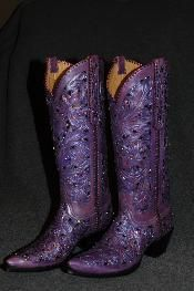Hand tooled fillagree, with metallic underlays and Swarovski Crystals  ~~ It is probably a good thing that I haven't won the lottery yet.  I would buy a pair of ungodly expensive boots just to say I did.  :)