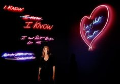 "Neon has become a favourite medium for many visual artists in recent decades. Here Tracey Emin poses with her artworks that ""confide the sodden regrets of the disillusioned morning after"""