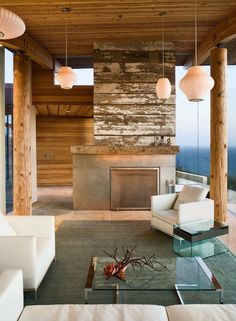 like the tree bark columns for under deck  Dani Ridge House by Carver + Schicketanz