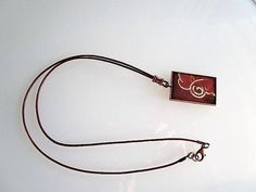 Copper bezel pendant brown leather cord abstract pattern