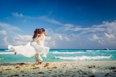 Playful bride and groom portrait taken by #DreamArtPhotography at Beach Palace in Cancun, Mexico. Special thanks to @prweddings