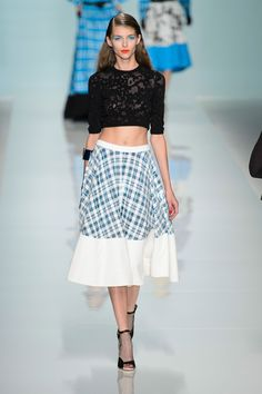 There was gingham and lace and midriffs and certainly the intention of something sexy. The color palette was blue, red, yellow—sometimes in their most bright versions and sometimes mixed together—and black and white.  Imaxtree  - HarpersBAZAAR.com