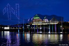 Drones form the shape of the Great Exhibition of the North logo in night sky above the Sage Gateshead.
