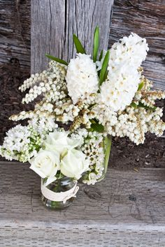 green and white flowers , beach wedding