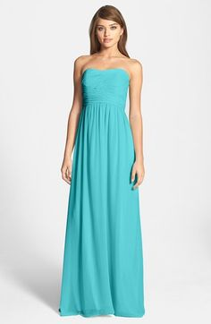 Free shipping and returns on Donna Morgan 'Stephanie' Strapless Ruched Chiffon Gown at Nordstrom.com. Exquisite ruching perfectly contours the bodice of this diaphanous chiffon gown augmented with a gracefully shirred, floor-sweeping skirt.