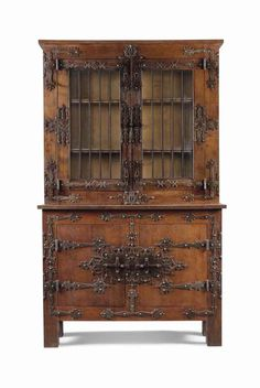 A GERMAN HISTORISMUS OAK CABINET WITH WROUGHT-IRON STRAPWORK  CIRCA 1900